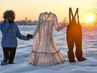 Davydova can be seen holding the clothes, which froze within minutes of being left outdoors, in Yakutia, Siberia last week (dailymail)
