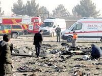 Rescue teams go through the debris after a Ukrainian plane carrying 176 passengers crashed in Tehran yesterday, killing all on board. Photo/AFP