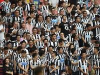Newcastle United fans look on during their match for third place against West Ham United in the 2019 Premier League Asia Trophy football tournament at the Hongkou Stadium in Shanghai on July 20, 2019. HECTOR RETAMAL / AFP