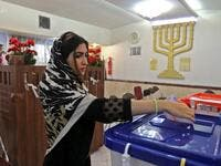 A Jewish Iranian woman casts her ballot at a polling station in the capital Tehran on February 21, 2020. Electoral authorities in Iran extended voting for two hours in the Islamic republic's parliamentary election on Friday, state television reported. ATTA KENARE / AFP