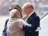 India's Prime Minister Narendra Modi (L) embraces US President Donald Trump upon his arrival at Sardar Vallabhbhai Patel International Airport in Ahmedabad on February 24, 2020. MANDEL NGAN / AFP