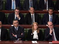 Elyes Fakhfakh, bottom right, has brought parties from across the political spectrum into his Cabinet — and they continue to disagree on several big policy areas. (AFP)