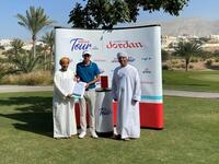 Ghala Open winner Bailey Gill receiving his Oman Open invitation from OGA Chairman Mundhir Al Barwani and OGA Vice Chairman Faisal Al Adawi.