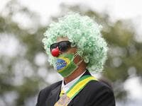 A supporter of the Brazilian President Jair Bolsonaro takes part in a protest against the National Congress and the Supreme Court while wearing a protective face mask to prevent the spread of the new Coronavirus, COVID-19, in Brasilia, on March 15, 2020. Sergio LIMA / AFP