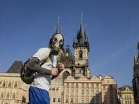 A man with a gas mask runs across the Old Town Square on March 18, 2020, in Prague, where activities came to a halt due to the spread of the novel coronavirus. The Czech Republic, a European Union country of 10.7 million people, has registered 464 confirmed cases of the virus, including three cured patients, and no deaths. Michal Cizek / AFP