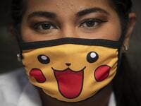 "A doctor wears a face mask as a precautionary measure against the spread of the new coronavirus, COVID-19, as she waits for patients at a market in Managua, on March 18, 2020. The Nicaraguan government, which has not officially reported Covid-19 cases, continues to accept the arrival of tourists and massive activities, an attitude considered ""irresponsible"" by the opposition and health professionals. Inti OCON / AFP"