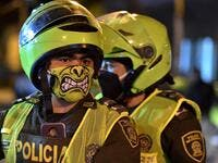 Police officers use face masks as a preventive measure against the spread of the new coronavirus, COVID-19, in Cali, Colombia on March 20, 2020. Colombian authorities announced a mandatory isolation simulation for the extended weekend, from March 21 to 23, as a preventive measure against the spread of the new coronavirus, COVID-19. Luis ROBAYO / AFP