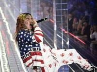 In this file photo taken on September 21, 2018 US rapper Tekashi 6ix9ine performs during the Philipp Plein fashion showw as part of the Women's Spring/Summer 2019 fashion week in Milan. MARCO BERTORELLO / AFP via Getty Images