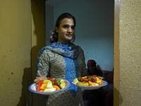 "In this picture taken on May 9, 2020, a member of the transgender community carries food for ""iftar"" before breaking their fast during the Islamic holy month of Ramadan at the Guru transgender house in Rawalpindi. Transgender people in the country are known as ""khawajasiras"" or ""hijras"" -- an umbrella term denoting a third sex that includes transgender women and cross-dressers. Pakistan became one of the first countries in the world to legally recognise a third sex in 2009 and began issuing transgender pass"