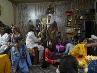 "In this picture taken on May 9, 2020, members of the transgenders community gather to break their fast during the Islamic holy month of Ramadan at the Guru transgender house in Rawalpindi. Transgender people in the country are known as ""khawajasiras"" or ""hijras"" -- an umbrella term denoting a third sex that includes transgender women and cross-dressers. Pakistan became one of the first countries in the world to legally recognise a third sex in 2009 and began issuing transgender passports from 2017. Aamir QU"