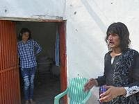 "In this picture taken on May 8, 2020, transgenders Adnan Ali (L) and Julie Khan (R) stand outside a shelter house in the Bari Imam neighbourhood of Islamabad. Transgender people in the country are known as ""khawajasiras"" or ""hijras"" -- an umbrella term denoting a third sex that includes transgender women and cross-dressers. Pakistan became one of the first countries in the world to legally recognise a third sex in 2009 and began issuing transgender passports from 2017. Aamir QURESHI / AFP"