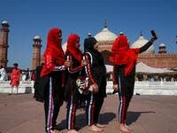 Muslim women take selfies after offering Eid al-Fitr prayers at the Badshahi Mosque in Lahore on May 24, 2020. Muslims around the world began marking a sombre Eid al-Fitr on May 24, many under coronavirus lockdown, but lax restrictions offer respite to worshippers in some countries despite fears of skyrocketing infections. Arif ALI / AFP