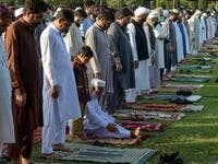 Muslims offer Eid al-Fitr prayers in Peshawar on May 24, 2020. Muslims around the world began marking a sombre Eid al-Fitr on May 24, many under coronavirus lockdown, but lax restrictions offer respite to worshippers in some countries despite fears of skyrocketing infections. Abdul MAJEED / AFP
