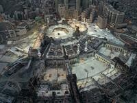 This picture taken on May 24, 2020 during the early hours of Eid al-Fitr, the Muslim holiday which starts at the conclusion of the holy fasting month of Ramadan, shows an aerial view of the Grand Mosque and Kaaba in the centre of Saudi Arabia's holy city of Mecca. Saudi Arabia began a five-day, round-the-clock curfew from May 23 after COVID-19 coronavirus infections more than quadrupled since the start of Ramadan to around 68,000 -- the highest in the Gulf. STR / AFP