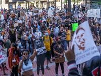 Protesters call for justice for George Floyd, a black man who died after a policeman kneeled on his neck for several minutes, at Hennepin County Government Plaza, on May 28, 2020 in Minneapolis (AFP/Kerem Yucel)