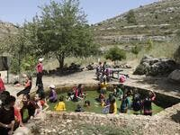 Israeli children from the nearby settlement of Shilo are pictured at a water spring on June 8, 2020 near the Palestinian village of Turmus'ayya in the occupied West Bank. The government of Israeli Prime Minister Benjamin Netanyahu has said it could begin the process to annex Jewish settlements in the West Bank as well as the strategic Jordan Valley from July 1. The plan -- endorsed by Washington -- would see the creation of a Palestinian state, but on reduced territory, and without Palestinians' core demand