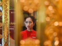 A staff member waits to welcome guests in the lobby of the newly-inaugurated Dolce Hanoi Golden Lake hotel, the world's first gold-plated hotel, in Hanoi on July 2, 2020. Manan VATSYAYANA / AFP