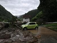 A car is seen among debris littering a village following heavy rains and flooding in the village of Takayama, Gifu prefecture on July 9, 2020. Japanese emergency services and troops were scrambling to reach thousands of homes cut off by devastating flooding and landslides that have killed dozens and caused widespread damage. Philip FONG / AFP