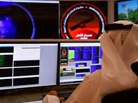 An employee works at the control room of the Mars Mission at the Mohammed Bin Rashid Space Centre (MBRSC), in the Gulf city of Dubai. The oil-rich United Arab Emirates has built a nuclear power programme and sent a man to space, and now plans to join another elite club by sending a probe to Mars. (AFP)