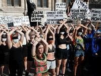 "Protesters perform a dance inspired by the Chilean feminist group ""Las Tesis"" during a demonstration called by feminist movements in front of the city hall in Paris, on July 10, 2020, to denounce the nomination of French Interior Minister, facing rape accusations and French Justice Minister who criticised the #MeToo movement against sexual harassment. Thomas COEX / AFP"