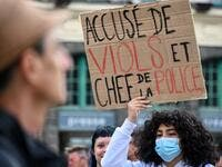 A protester holds a placard reading 'accused of rape and police chief' during a demonstration called by feminist movements on the main square of Lille, on July 10, 2020, to denounce the nomination of French Interior Minister, facing rape accusations and French Justice Minister who criticised the #MeToo movement against sexual harassment. DENIS CHARLET / AFP