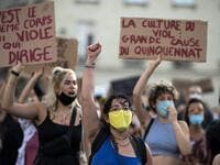 A protester holds their fist up during a demonstration called by feminist movements in Nantes, western France, on July 10, 2020, to denounce the nomination of French Interior Minister, facing rape accusations and French Justice Minister who criticised the #MeToo movement against sexual harassment. LOIC VENANCE / AFP