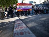 Protesters hold signs and banners as they take part in a demonstration called by feminist movements in Nantes, western France, on July 10, 2020, to denounce the nomination of French Interior Minister, facing rape accusations and French Justice Minister who criticised the #MeToo movement against sexual harassment. LOIC VENANCE / AFP