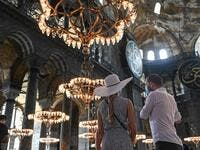 Tourists visit the inside of Hagia Sophia on July 10, 2020, in Istanbul, before a top Turkish court revoked the sixth-century Hagia Sophia's status as a museum, clearing the way for it to be turned back into a mosque. (AFP)