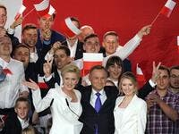 Polish President Andrzej Duda flashes V-signs after addressing supporters with his wife Agata as exit poll results were announced during the presidential election in Pultusk, Poland, on July 12, 2020. Poland's right-wing head of state Andrzej Duda was ahead by a tiny margin in the presidential run-off against Warsaw's liberal mayor, an exit poll on on July 12, 2020 showed, starting a tense wait for the official results JANEK SKARZYNSKI / AFP