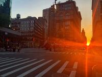Manhattanhenge happens four times a year, when the sun rises or sets parallel to the street grid in Manhattan (Twitter)