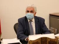 Lebanon's Foreign Minister Nassif Hitti is pictured wearing a face mask due to the coronavirus in his office in the capital Beirut, on August 3, 2020. Hitti announced his resignation today due to the government's mishandling of the country's worst crisis in decades, as premier Hasan Diab's under-fire cabinet struggles to secure international support. ANWAR AMRO / AFP
