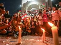 Palestinians attend a candle light vigil in Rafah in the southern Gaza Strip on August 5, 2020, in support of Lebanon a day after a blast in a warehouse in the port of the Lebanese capital sowed devastation across entire city neighbourhoods. SAID KHATIB / AFP