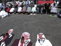 Palestinians perform take part in the Friday prayers in front of cut-outs showing the faces of (L to R) Israeli Prime Minister Benjamin Netanyahu, Abu Dhabi Crown Prince Sheikh Mohammed bin Zayed al-Nahyan, and US President Donald Trump, during a demonstration in Nablus in the occupied West Bank on August 14, 2020 against a US-brokered deal between Israel and the UAE to normalise relations. The deal marks only the third such accord the Jewish state has struck with an Arab nation, an historic shift making th