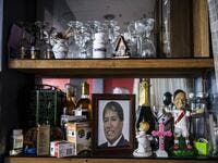 View of a photo of Peruvian Ernesto Diaz, 55, who died from COVID-19 virus on a shelf of his home in Chorrillos, south of Lima, Peru on August 11, 2020. Global deaths from the coronavirus have almost reached on September 25, 2020 the grim threshold of one million. Around one-third of fatalities were in Latin America, where countries with overstretched medical resources are preparing for a further onslaught. ERNESTO BENAVIDES / AFP