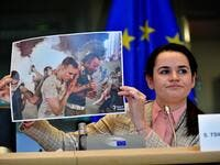 Belarus opposition leader Svetlana Tikhanovskaya holds up a photograph as she addresses members of the EU parliament at the EU headquarters in Brussels on September 21, 2020. European foreign ministers welcomed Belarus opposition leader Svetlana Tikhanovskaya to Brussels as they prepare EU sanctions to support her battle against the Minsk regime. The former Soviet republic has been convulsed by unprecedented demonstrations against President Alexander Lukashenko since he was returned to power in a disputed A