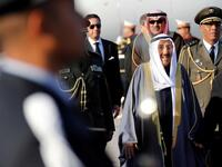 A 2019 file picture shows Kuwait's Emir Sheikh Sabah Al-Ahmad Al- Jaber Al-Sabah reviewing an honour guard upon his arrival in Tunis to attend the Arab Summit. (AFP)