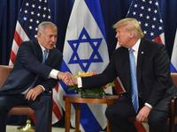 US President Donald Trump shakes hands with Israeli Prime Minister Binyamin Netanyahu. (AFP)