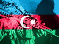Soldier with machine gun with national flag of Azerbaijan  (Shutterstock)