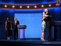 US First Lady Melania Trump (L) stands with US President Donald Trump as Jill Biden (R) hugs husband Democratic Presidential candidate and former US Vice President Joe Biden after the conclusion of the final presidential debate at Belmont University in Nashville, Tennessee, on October 22, 2020. Jim WATSON / AFP