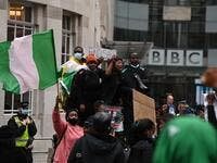 "Protestors shout slogans during a protest action against police brutality in Nigeria, outside the BBC offices in central London on October 24, 2020. UN Secretary General Antonio Guterres has called for an end to what he called ""brutality"" by police in Nigeria, which has been rocked by two weeks of protests. Guterres said gunmen that opened fire on peaceful protesters Tuesday evening in Lagos caused ""multiple deaths"" and many injuries. DANIEL LEAL-OLIVAS / AFP"