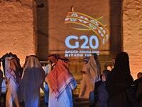 The G20 logo is projected at the historical site of al-Tarif in Diriyah district, on the outskirts of Saudi capital Riyadh, on November 20, 2020. Saudi Arabia hosts the G20 summit on November 21 in a first for an Arab nation, with the downsized virtual forum dominated by efforts to tackle a resurgent coronavirus pandemic and crippling economic crisis. FAYEZ NURELDINE / AFP