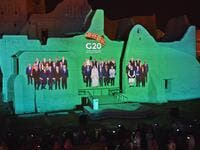 A family photo of G20 Leaders is projected at the historic site of al-Tarif in Diriyah district, on the outskirts of Saudi capital Riyadh, ahead of G20 virtual summit on November 20, 2020. FAYEZ NURELDINE / AFP