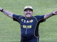In this file photo taken on September 10, 2018 Argentine legend Diego Maradona gestures during his first training session as coach of Mexican football club Dorados, at the Banorte stadium in Culiacan, Sinaloa State, Mexico. (AFP/ Pedro Pardo)