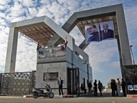 Portraits of Egyptian President Abdel Fattah al-Sisi and Palestinian leader Mahmud Abbas hang at the Rafah border crossing with Egypt. (Said Khatib, AFP )