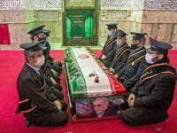 Members of the Iranian armed forces pray around the coffin of slain nuclear scientist Mohsen Fakhrizadeh during the burial ceremony in Tehran, on Nov. 30. HAMED MALEKPOUR/TASNIM NEWS/AFP VIA GETTY IMAGES