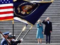 US President Joe Biden salutes as First Lady Jill Biden puts her hand on her heart as they review the readiness of military troops in a pass in review on the east steps of the US Capitol in Washington, DC, on January 20, 2021, after being sworn in at the US Capitol. David Tulis / POOL / AFP