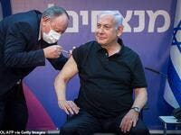 Israeli Prime Minister Benjamin Netanyahu, pictured being given the vaccine on 9 January, pledged to vaccinate every citizen by the end of March. (AFP)