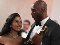 In this file photo taken on March 05, 2018 US actor and basketball player Kobe Bryant (R) holds an oscar beside his wife Vanessa Laine Bryant during the 90th Annual Academy Awards in Hollywood, California. (ANGELA WEISS / AFP)