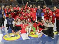 Bahrain's players pose for a photo as they celebrate after winning the 2021 World Men's Handball Championship match between Group D teams Bahrain and DR Congo at the Cairo Stadium Sports Hall in the Egyptian capital on Jan 19, 2021. (Photo: AFP)
