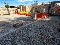 This picture shows the mosaic flooring of the Saint Mary church, built in 543 AD, the restoration of which was recently completed by workers employed by a pilot project run by the UN cultural agency UNESCO, in the small town of Rihab, some 70 kilometres north of the Jordanian capital Amman, on February 9, 2021. In the ruins of the ancient Byzantine church in Jordan, local townspeople and Syrian refugees work side by side on a project that unites preserving cultural heritage and fighting poverty.  Khalil MAZ